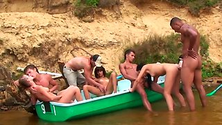 Young and beautiful people are fans of nudism and are having fun in nature