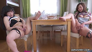 Japanese stepsisters are masturbating pussies sitting in front of each other