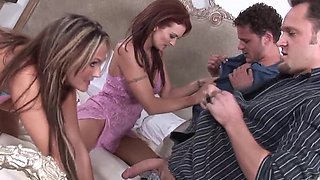 Two women are with two men on the bed, swapping partners