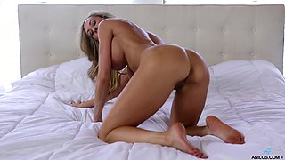 Slender MILF with rock hard abs and a big ass loves masturbating in her bed