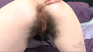 Very hairy Laufy strips and masturbates on purple bed