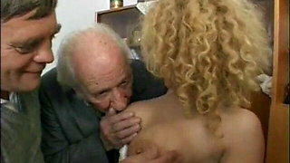 Two old men and a young blonde girl