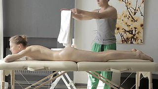 When Argentina lies all naked on a massage table she