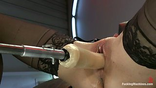 Hot chick in stockings gets drilled by the fucking machine