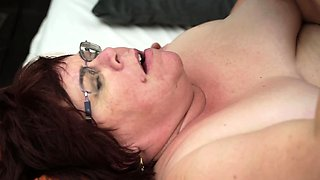 Fat old woman is getting penetrated by a horny young man on bed