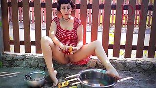 Retro Maid Prepares Potatoes For Dinner. Vintage Performance