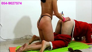 Sexy brunette punishes a guy's fiery ass with a strap-on toy