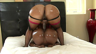 Bubble but ebony lesbians fuck with a strap on in bed