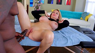 Busty chick Corinna Blake rides a black cock while her tits bounce