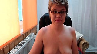 Sensuous webcam lady in stockings teases with a strap-on toy