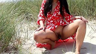 Asian Girl Pissing on the Beach