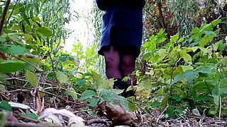 Russian milf in boots and sexy stockings pissing outdoors