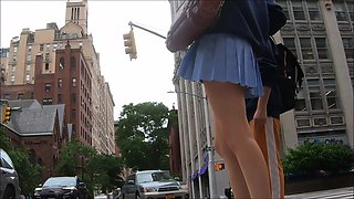 young blonde with short skirt, long legs and a small thong