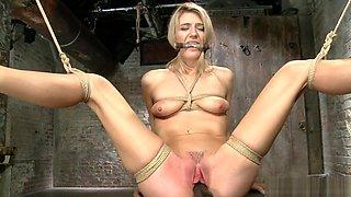 Skinny blonde in back arch bondage toyed