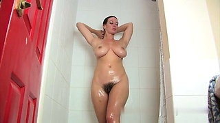 Curly haired woman bathing