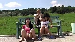 Two naughty babes piss in public and giggle about it
