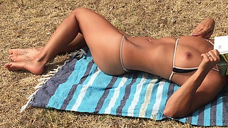Watching wife sunbathing and flashing her hot bikini at park