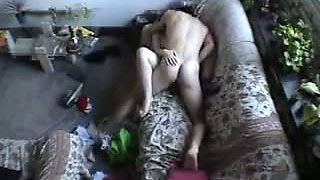 Nasty couple banging on the sofa and being filmed on a spy camera