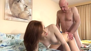 Redhead beauty is totally absorbed with riding strong old cock on top