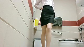Charming secretary tapes herself doing nasty things in the office toilet