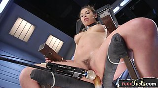 Restrained babe cumming during machine sex