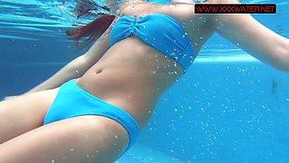 Steamy Small teen Mia Ferrari strips naked in pool