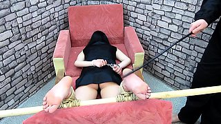 Helpless amateur brunette gets her sexy little feet punished
